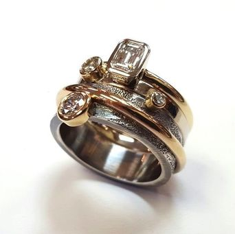 Trios contemporary ring restyled from family gems.